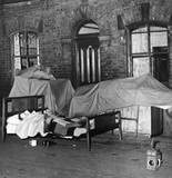 Evicted family sleeping in the street, Ashton-under-Lyne, 20 June 1950.