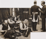 Tailors sewing military uniforms, April 1930.