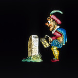A man by a tombstone. Hand-coloured magic l