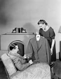 """Woman showing a man a dress, 1948."""