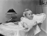 """Baby in a cot, 1956."""