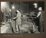 """'Woman assisting in the making of rivets', 1915-1918."""