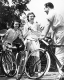 """Three cyclists with tennis racquets, 1940s."""