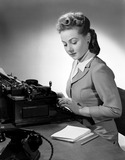 """Woman typing, 1949."""