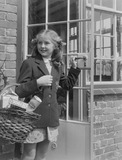 """Girl carrying a shopping basket, 1949."""