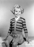 """Little girl in a knitted cardigan, c 1950."""