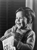 """Little boy with a cereal packet, 1948."""