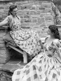 """Two women in summer clothes, c 1948."""