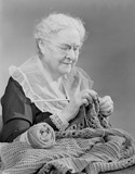 """Elderly woman knitting, 1949."""