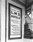 """LMS poster at Manchester Victoria Station, 1925."""