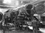 """Working on a locomotive, Bristol, c 1934-1938."""