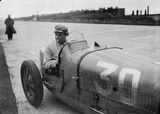 """""Williams"" at the wheel of a Bugatti Type 51 racing car, Nurburgring, 1931."""