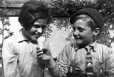 Young boy offering his ice cream to a girl.