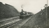 LMS 0-6-0 locomotive No.3641 with a goods train passing over water troughs near Tamworth, 25th August 1928. S.T. Cowan, Ia_101, Album 8.