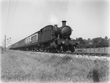 Locomotive no. 5502 up express, 8 coaches, at Barnstaple Junction c.1930. (Arthur A Halls, HALL_G_40).