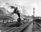 Class V2 2-6-2 steam locomotive, No. 4813, leaving Gas Works tunnel Kings Cross with a modest down express, 1939.