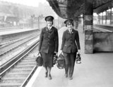 First women railway guards take over duties at London terminus - 19-July-1943