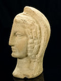 Left half of a a terracotta female head, Roman, 200 BCE-200 CE.
