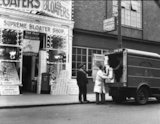 Great Yarmouth - postmen collecting boxes of fish from a shop - 1937