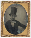 Boy wearing a top hat, about 1858