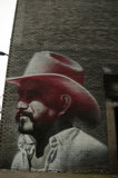 Mural of cowboy by El Mac in East London