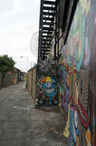 Graffiti street view of cartoon characters in East London