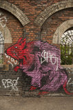 Graffiti in East London of rat on archway