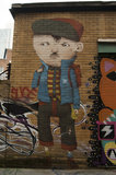 Graffiti in East London of boy by Amigo