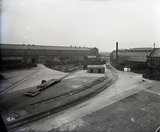 Works photographic negative of exterior view of the boiler shop yard and engine test sheds from the wheel shop, 1959.