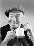 Portrait of a man smoking and drinking from a mug, 1949