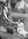 Couple having a picnic, c 1950.