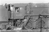 A close up of a steam locomotive cab with a driver. ,A1969.70/Box 5/Neg 1273/11