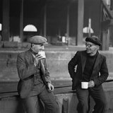Barge captain drinking tea, c 1950.