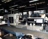 Automic 'Negri Bosi' injection moulding machine and operator, c 1985.