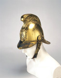 Bras firefighting helmet, c 1880-1920.