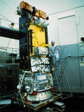 NOAA satellite with technician, 1970s.