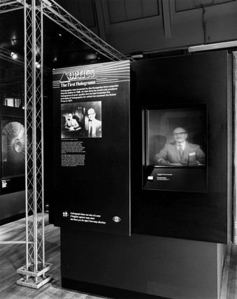 Exhibition showing image of Dennis Gabor, British inventor of holography, 1988.