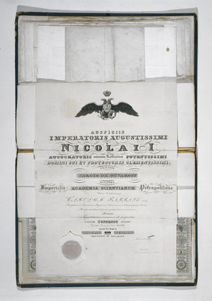 Open folio of diplomas awarded to Charles Babbage, 19th century.