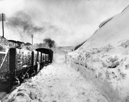 Freight train hauled by a steam locomotive on a snow-bound line between Dent Head and Arten Gill, February 1947.