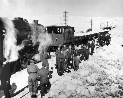 Troops clearing snow at Arten Gill on the London, Midland and Scottish Railway's Settle and Carlisle line, March 1947.