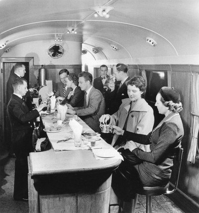 Pasengers seated at counter in British Railways Buffet Carriage, 1951.
