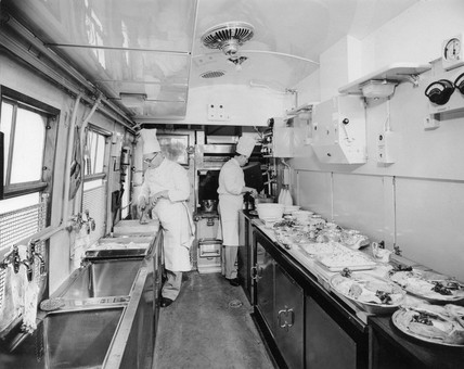 Chefs prepare pasengers' lunch in British Railways kitchen car, March 1951.