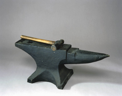 Anvil and hammer, c 1890.