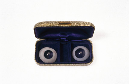 Pair of glas eyes in a case.