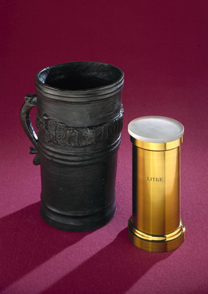 Bronze Exchequer standard gallon measure, c 1495, and litre measure.