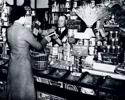 Woman buying groceries, 24 June 1937.