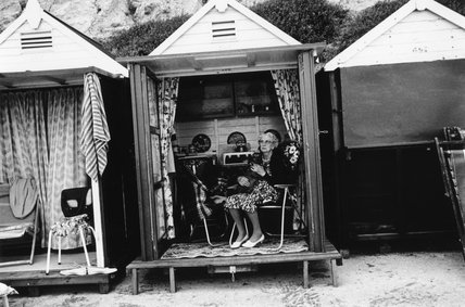 Elderly woman seated in a beach hut, 1968.