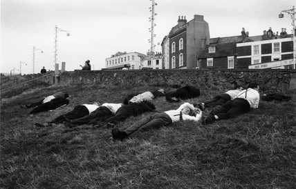 Young and middle-aged men lying on grassy hill near B2052 trunk road, 1967.