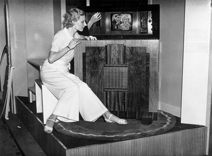 Woman watching a Marconi mirror lid television, Radiolympia, London, 1936.