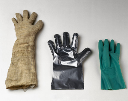 Three protective gloves, c 1982-1996.
